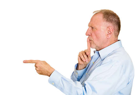 admonish: Closeup side view profile portrait, senior mature man placing fingers on lips with shhh sign symbol, isolated white background. Negative emotion facial expression feelings, body language