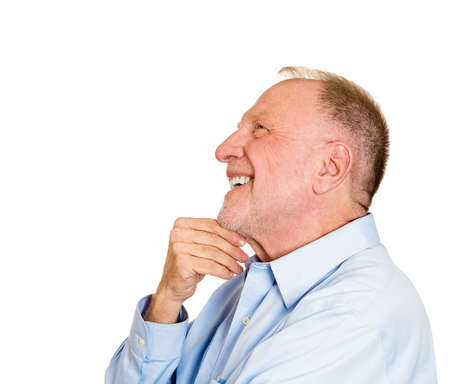 man side: Closeup side view profile portrait, senior mature man, daydreaming about something that makes him happy, looking up, isolated white background. Positive human emotion facial expression feelings. Stock Photo