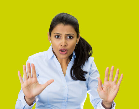 Closeup portrait, furious, mad, angry, annoyed, displeased young woman raising hands up to say no, stop right there, isolated green background. Negative human emotion facial expression sign symbol Stok Fotoğraf - 27626261