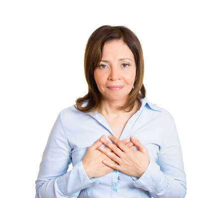 obliged: Closeup portrait, mature woman worker with hands clasped to chest, very thankful looking at you, camera, isolated white background. Positive human emotion, facial expression
