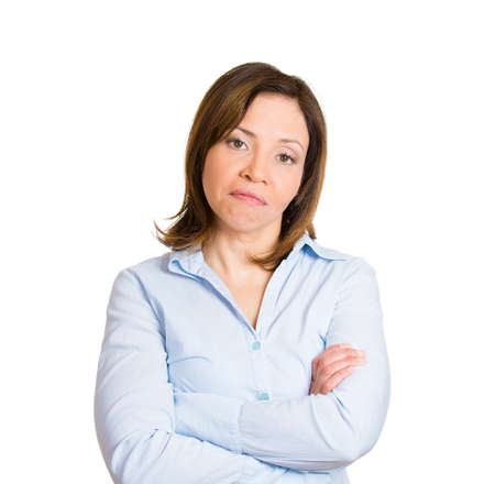 asian youth: Closeup portrait, displeased pissed off angry grumpy young woman with bad attitude, arms crossed looking at you, isolated white background. Negative human emotion facial expression feeling