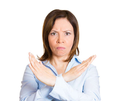 admonish: Closeup portrait, angry mature woman with X gesture to stop talking, cut it out, dont go there, isolated white background. Negative emotion facial expression feelings, signs symbols, body language Stock Photo