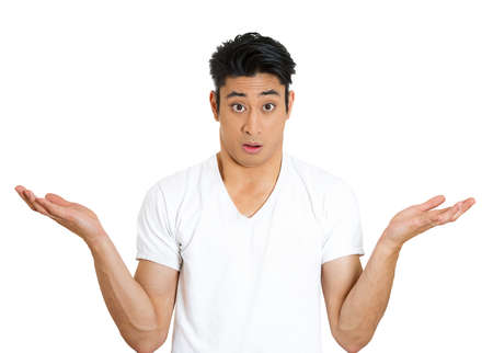 stupid body: Closeup portrait of dumb clueless young man, arms out asking why whats the problem who cares so what, I dont know. Isolated on white background. Negative human emotion facial expression feelings Stock Photo