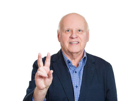 Senior, bald, smiling business man, holding up peace, victory, two sign, isolated white background.  photo