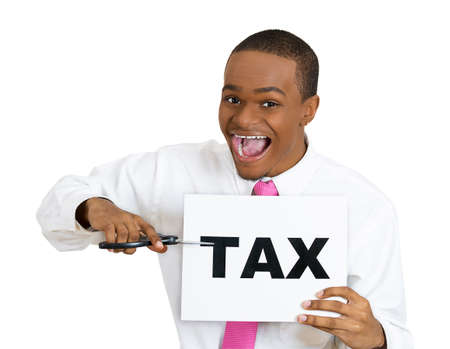 Closeup portrait, excited, happy, energetic enthusiastic young business man, funny looking guy, worker, dedicated employee cutting taxes with scissors, isolated white background. Government. IRS. Stock Photo - 27605657