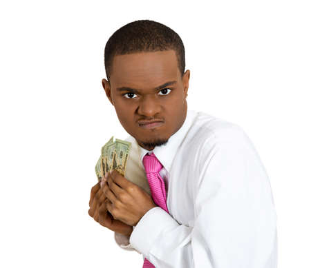 pennypinching: Closeup portrait greedy banker, executive, CEO boss, corporate employee funny looking business man, holding dollar banknotes, money, suspicious, sarcastic, isolated white background. Face expressions