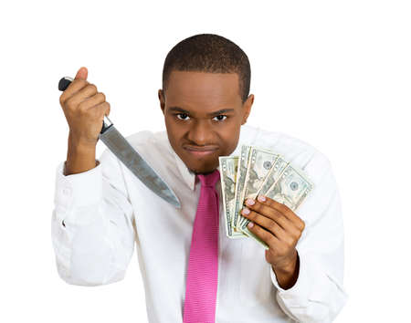 miserly: Closeup portrait, greedy banker, executive CEO boss, corporate employee, funny angry looking man holding dollar banknotes and knife ready to kill for money, isolated white background. Expressions Stock Photo