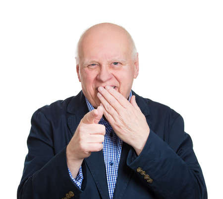 humiliation: Closeup portrait senior mature business man laughing, pointing with finger at someone, something, isolated white background. Positive human face expression, emotion, feeling, attitude, reaction Stock Photo