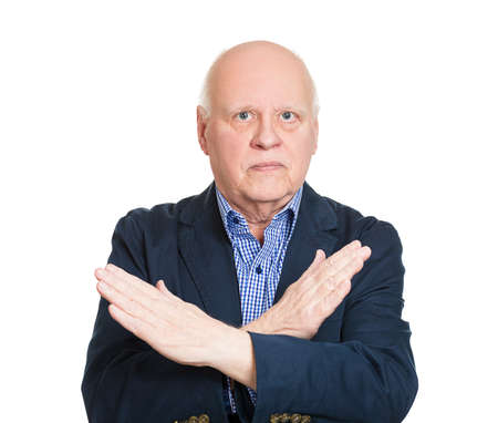 shutup: Closeup portrait senior business man with hands crossed sign asking stop talking, isolated white background. Negative emotions, facial expressions, feelings, body language symbol, reaction. Conflict Stock Photo