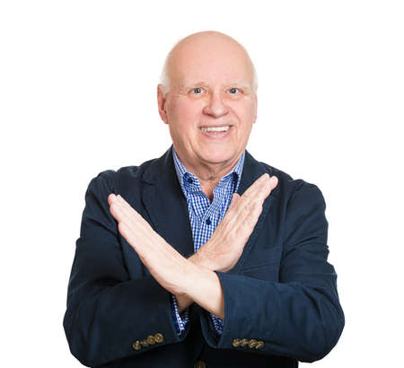 shutup: Closeup portrait, senior mature man with hands in X sign telling someone to stop talking, isolated white background. Human emotions, facial expressions, feelings, body language symbols. Power, control