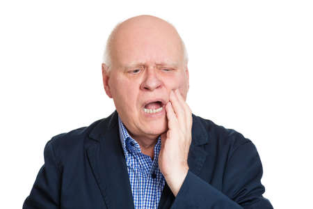 Closeup portrait elderly business man with tooth ache crown problem cavity crying from pain touching outside mouth with hand isolated white background. Negative human emotion facial expression feeling Stock Photo - 27605803