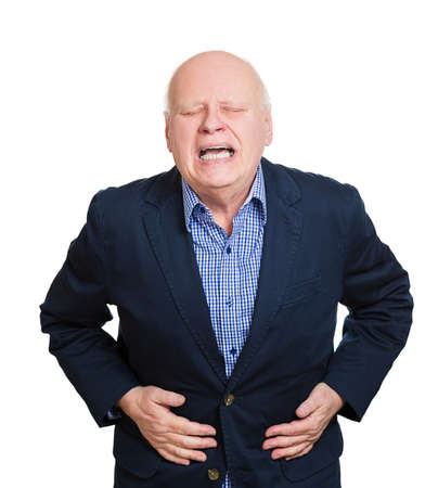 duodenal: Closeup portrait old business man, elderly executive, boss, corporate worker, retired guy, unhealthy grandfather doubling over in stomach pain, isolated white background. Human emotions. Acute abdomen Stock Photo