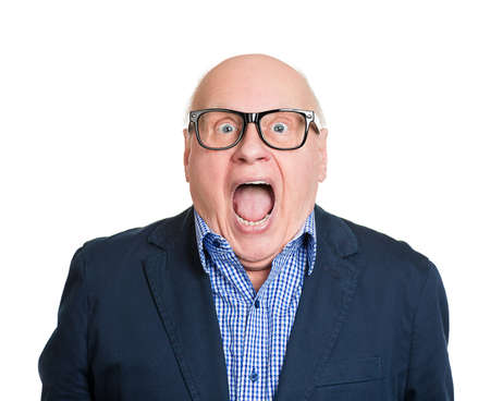Closeup portrait senior, elderly man in glasses, looking shocked, surprised in full disbelief, wide open mouth, eyes, isolated white background. Human emotions, facial expressions, feelings, reaction Stock Photo