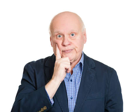 fidgety: Closeup portrait, goofy senior mature man, finger on cheek, bored out of mind, annoyed by you talking, isolated white background. Negative emotion facial expression feelings, reaction, attitude Stock Photo