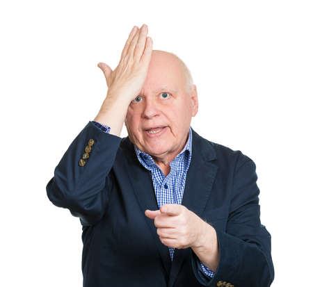 duh: Closeup portrait goofy, senior, mature, old business man slapping hand on head, duh, isolated white background. Negative human emotions, facial expression, feelings, body language, reaction to mistake