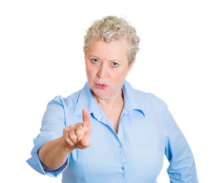 incriminate: Closeup portrait, angry, senior mature unhappy, serious woman pointing at someone, you did something wrong, bad boy, isolated white background. Negative human emotions, facial expressions, feelings