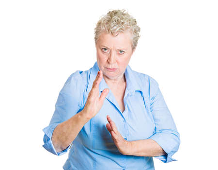 deranged: Closeup portrait, angry, mad, furious woman raising hands in the air attack with karate chop, isolated white background. Negative emotion facial expression feelings, body language, signs, symbols Stock Photo
