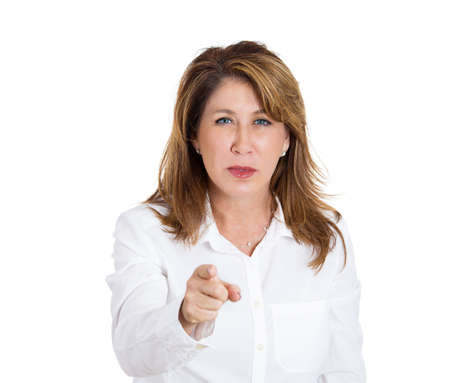 angry teacher: Closeup portrait, mature middle-aged unhappy, serious woman pointing two hands at someone, you did something wrong, bad mistake, isolated white background. Negative emotion, facial expression feeling