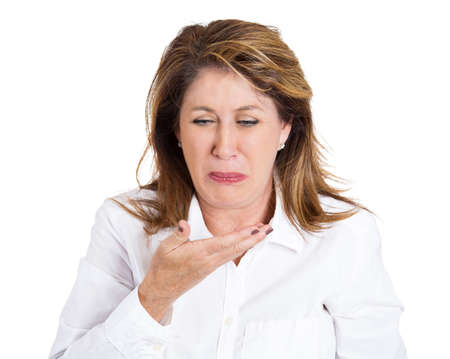 queasy: Closeup portrait, mature unhappy, annoyed, sick woman about to chuck, throw up, puke retch barf, hurl isolated white background. Negative emotions, feelings, facial expressions. Excessive drinking Stock Photo