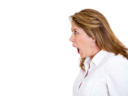 unprofessional: Closeup side view profile portrait, mad, angry, upset, hostile middle aged woman, worker, furious employee, yelling, screaming, isolated white background. Negative emotions, facial expression reaction Stock Photo
