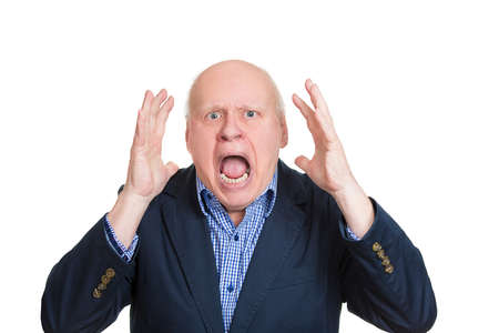 Closeup portrait, mad, upset, senior mature man, funny looking business man, hands in air, open mouth yelling, isolated white background. Negative human emotion facial expression, reaction photo