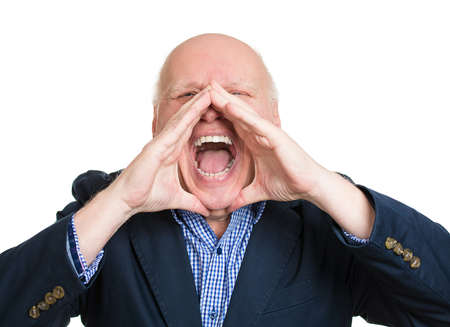 Closeup portrait, mad, upset, senior mature man, funny looking business man, hands to open mouth yelling, isolated white background. Negative human emotion facial expression, reaction photo
