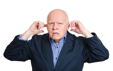 loud noise: Closeup portrait, senior mature man, covering closed ears, annoyed by loud noise or ignoring someone, not wanting to hear their side of story, isolated white background. Negative emotion