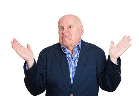indifferent: Closeup portrait, dumb clueless senior mature man, arms out asking why whats the problem who cares so what, I dont know. Isolated white background. Negative human emotion facial expression feelings Stock Photo