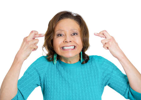 genie woman: Closeup portrait, senior mature, funny looking woman crossing fingers, wishing, praying for miracle, hoping for best, isolated white background. Positive emotion, facial expression feeling attitude