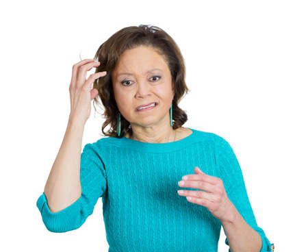 memory loss: Closeup portrait, senior mature woman, scratching head, memory loss, trying to recall information, isolated white background. Negative emotion facial expression feelings. Geriatric health issues