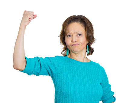 Closeup portrait, smiling senior mature woman flexing muscles showing displaying her gun show, isolated white background. Positive human emotion facial expression feelings, attitude, perception photo