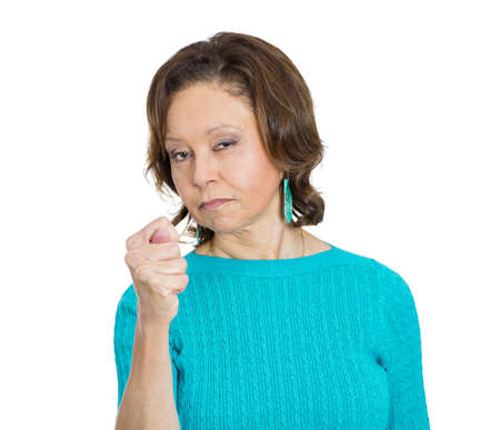 Closeup portrait, senior mature woman gesturing with thumbs and finger that you get zero nothing, isolated white background. Negative human emotion facial expression feelings, body language signs photo