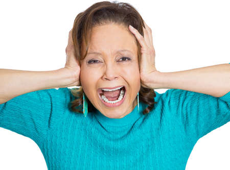 errands: Closeup portrait worried, stressed, overwhelmed, senior mature woman, upset covering ears, screaming, going crazy nuts, isolated white background. Human emotion, facial expressions, reaction, attitude
