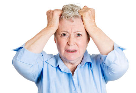 Closeup portrait, stressed, senior mature woman pulling hair out, about to have nervous breakdown, isolated white background. Negative human emotions, facial expressions, reactions, attitude, feeling photo