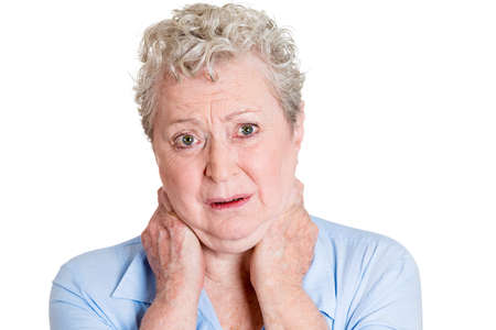 spondylitis: Closeup portrait, really stressed unhappy, senior mature woman with bad neck spasm pain, after long hours of work, studying, isolated white background. Negative human emotions, facial expressions