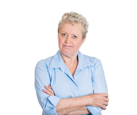 angry teacher: Closeup portrait, pissed off, angry, grumpy, senior mature woman with bad attitude, arms crossed, folded looking at you, isolated white background. Negative human emotion facial expression feeling