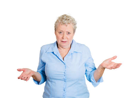 disinterest: Closeup portrait, angry unhappy senior mature woman with arms out asking whats the problem, who cares, so what, I dont know. Isolated white background. Negative human emotions facial expression Stock Photo
