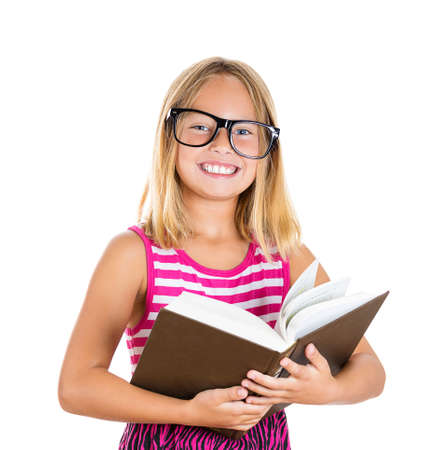 Closeup portrait, adorable, beautiful girl with big black glasses reading a brown book, isolated white background. Positive human emotion facial expression, feelings photo