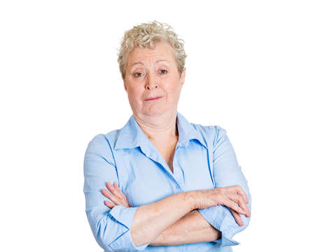 disapproval: Closeup portrait, skeptical, senior mature woman looking suspicious, disgust and disapproval on face, arms crossed folded, isolated white background. Negative human emotion, facial expression, feeling