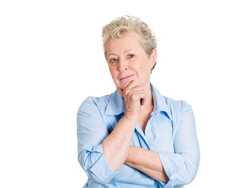 perfectionist: Closeup portrait, senior mature woman, resting chin on hand, deep thought, analyzing a choice, isolated white background. Negative emotions, facial expressions, feelings, body language, attitude Stock Photo