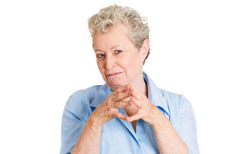 insidious: Closeup portrait sneaky, evil, sly, scheming senior mature woman trying to plot, plan something, screw, hurt someone, isolated white background. Negative human emotions, facial expressions, feelings Stock Photo