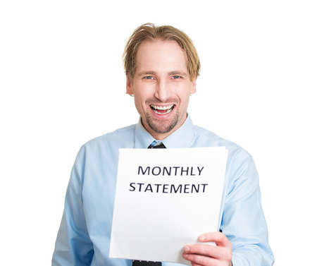 Closeup portrait, happy excited young business man looking at monthly statement, glad pay off bills, isolated white background. Positive emotion facial expression feeling. Financial success, good news photo