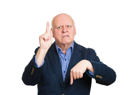 baffled: Closeup portrait confused, senior mature man pointing in two different directions, not sure which way to go life, hesitant to make decision isolate white background. Emotion, facial expression feeling