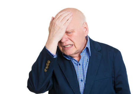 amnesia: Closeup portrait, confused senior mature man placing hand on head, face palm gesture in duh moment, isolated white background. Negative human emotion facial expression feelings, body language