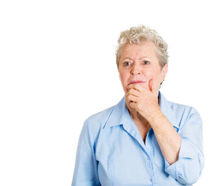 bothered: Closeup portrait, senior mature woman in deep, serious thought, daydreaming of problems, looking up, isolated white background. Negative human emotion facial expression feelings. Stock Photo