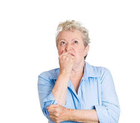 deeply: Closeup portrait, senior mature woman, pondering something deeply, pissed off, annoyed, looking up, isolated white background. Negative human emotion facial expression feelings Stock Photo