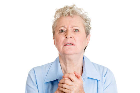 solicit: Closeup portrait, senior mature woman gesturing with clasped hands, pretty please with sugar on top, isolated white background. Positive emotion facial expression feelings, signs symbol, body language