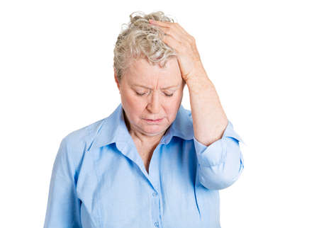 grievous: Closeup portrait, sad, alone, dark, gloomy, frustrated, stressed senior mature woman, hand on head, just realizing she made a serious, grievous error. Negative human emotion facial expression feelings Stock Photo