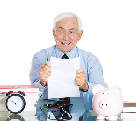repayment: Closeup portrait, happy excited senior mature man looking at monthly statement glad pay off bills, isolated white background. Positive emotion facial expression feelings. Financial success, good news