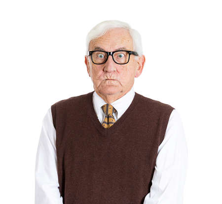 Closeup portrait, senior elderly teacher with black glasses, so angry, unhappy and grumpy, about to explode, isolated white background. Negative human emotions and facial expressions. photo